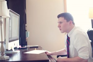 student works through a technology issue